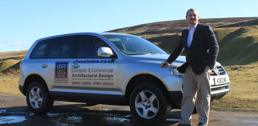 Clive Elsdon with his sign writted car promoting his Architectural Design Business